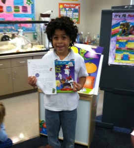 Elijah receives a new book with his PencilPALS letter.